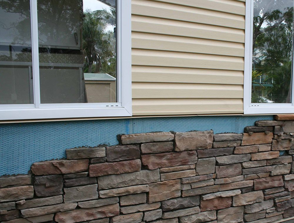 Как правильно облицовывать цоколь дома искусственным камнем